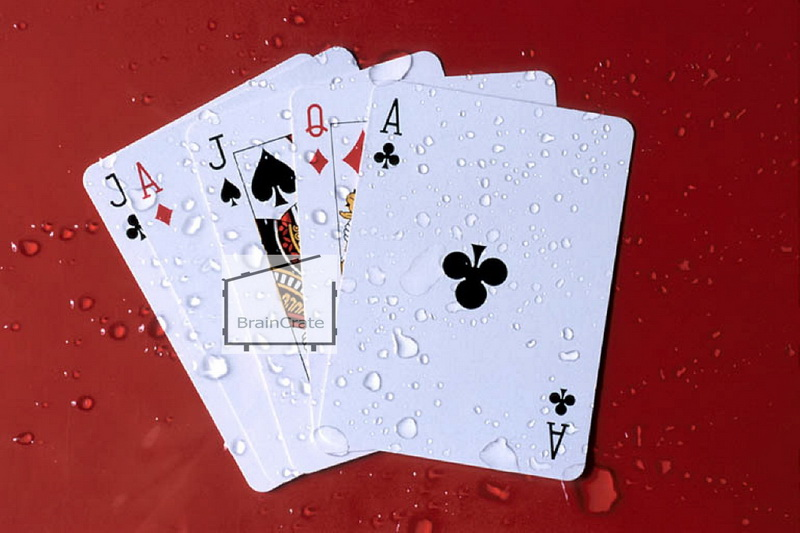 playing cards in the rain